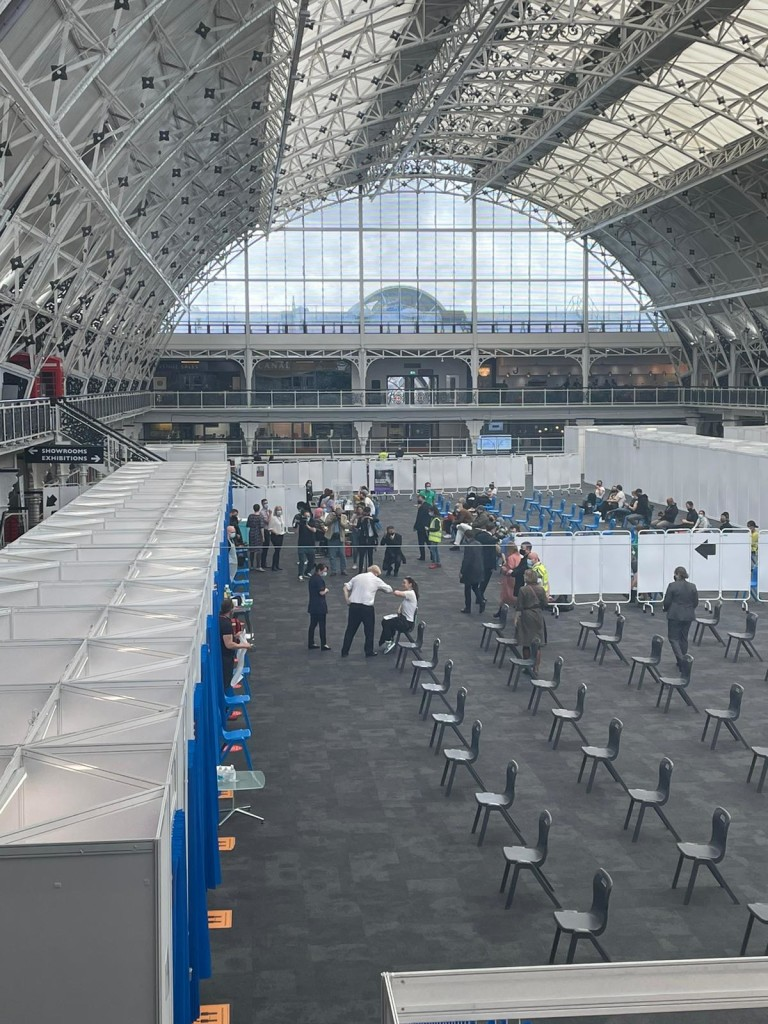 Above: Boris Johnson talking to one of the people who had come to be vaccinated. In just over two months' time the BDC hall will be full of card companies and retailers at PG Live!
