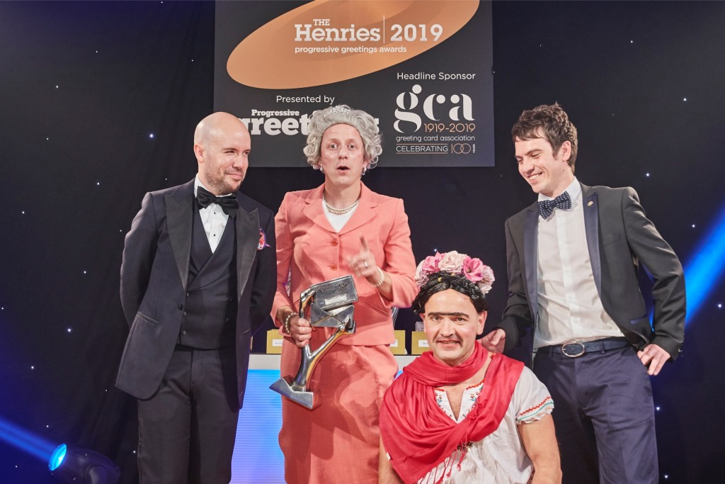 Above: Brainbox Candy Boys, Ben Hickman (second left) and Mark Williams (second right) all dressed up for The Henries 2019, collecting their award from The Imaging Centre's Adam Short (far right) and host Tom Allen. (The awards took place virtually in 2020).