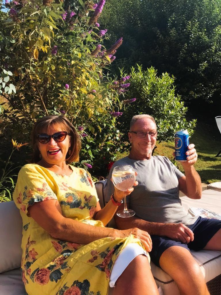 Above: Maggie and her husband John enjoying a celebratory drink!