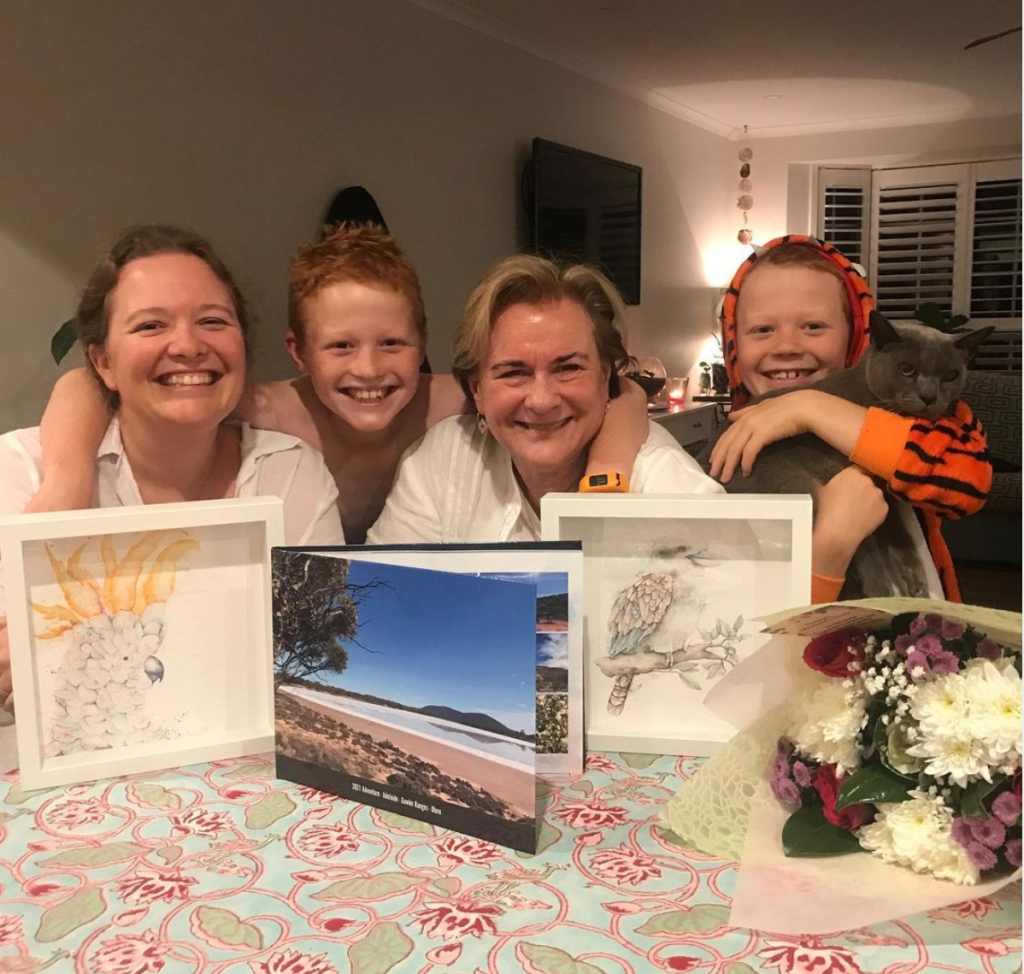 Above: Sydney-based Jenny Cummins, md of McMillan Cards with her daughter Lisa, grandsons Reilly and Finn and their cat Johnnie Blue.