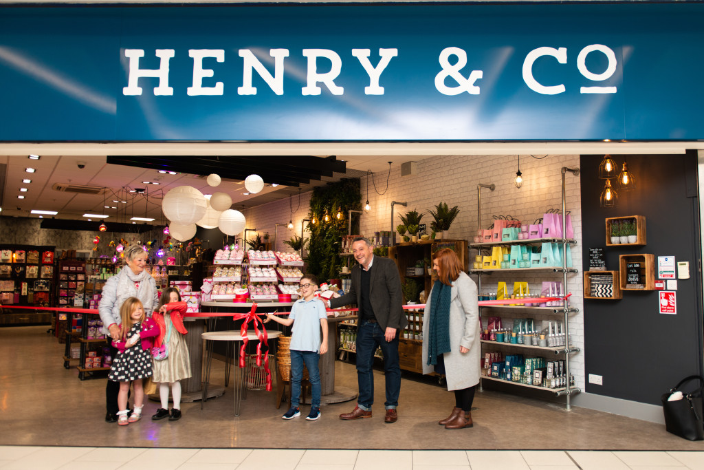 Above: Mark Rees and his family outside the first Henry & Co store, that launched in Nottingham last year.