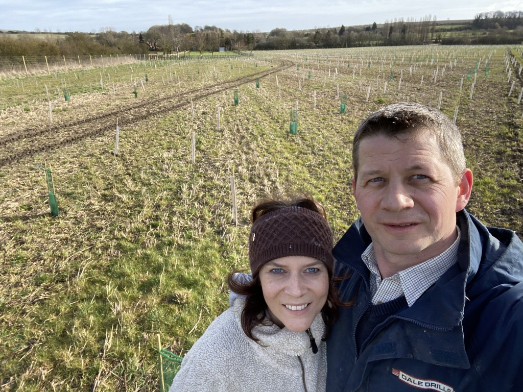 Above: Hannah and Jack Dale have undertaken a huge rewilding project on their land, which has involved planting 28,000 trees. Here they are having just finished the planting!