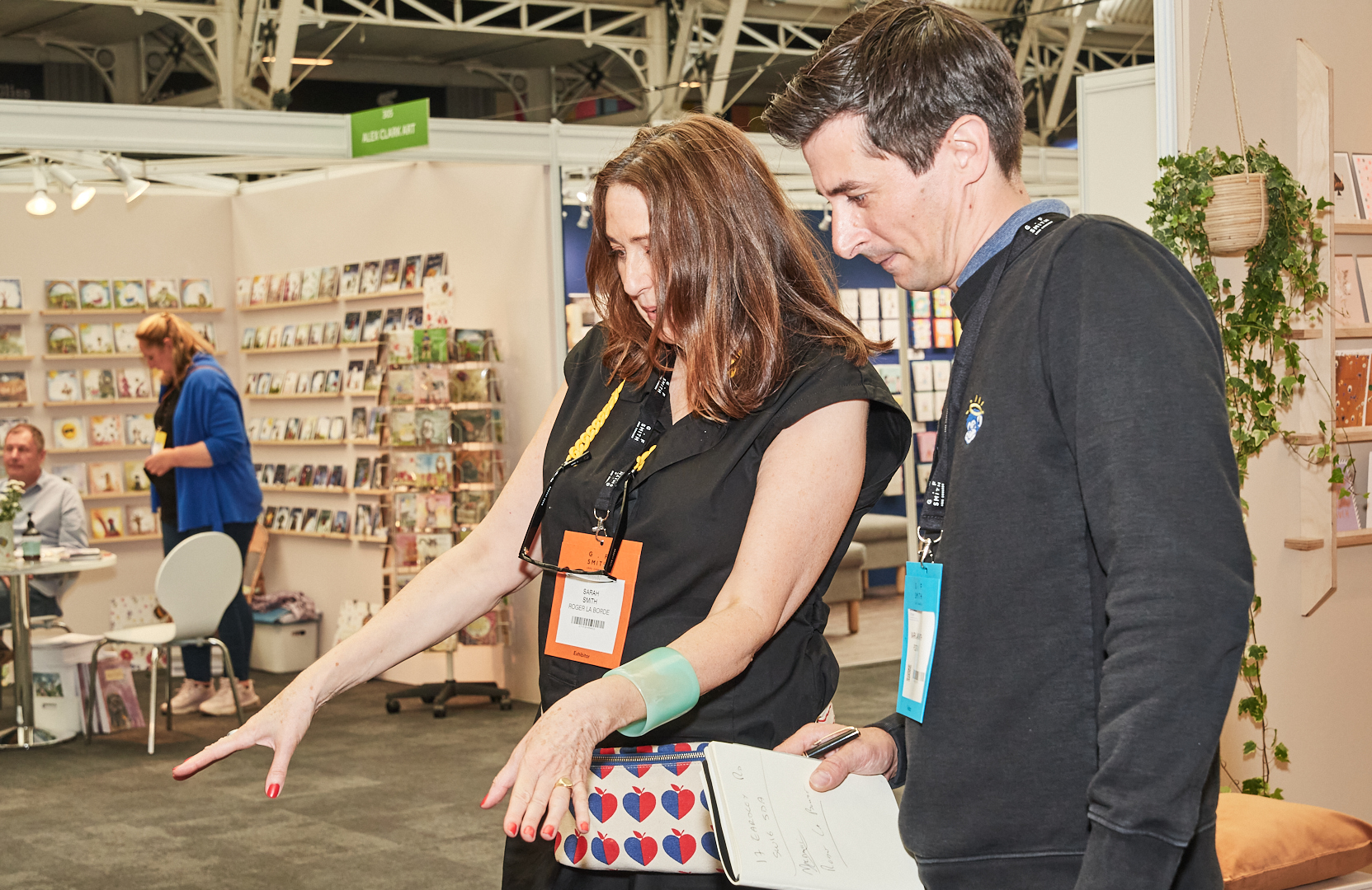 Above: Mark Janson-Smith taking a close look at some of Roger la Borde's lovely products with the publisher's Sarah Smith