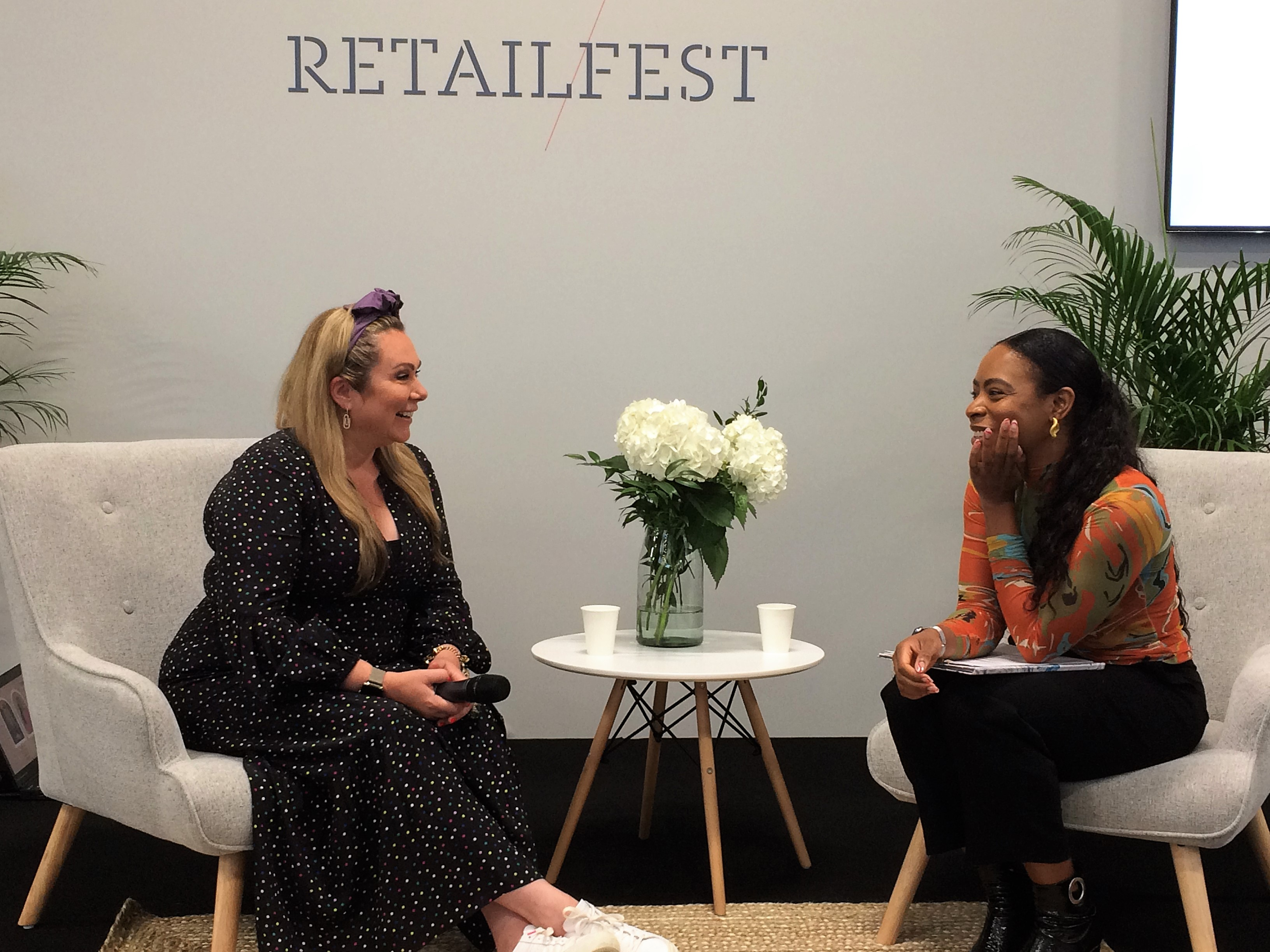 Above: Holly Tucker MBE, at Top Drawer in conversation with Tiwalola Ogunlesi, founder of Confident and Killing It.