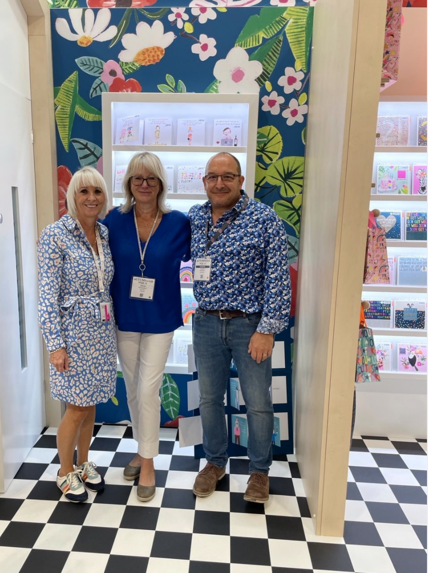 Above: Paper Salad's Karen Wilson (left) colour co-ordinated with agents Joanna McFarlane and Ian Bradley on the stand at the show.