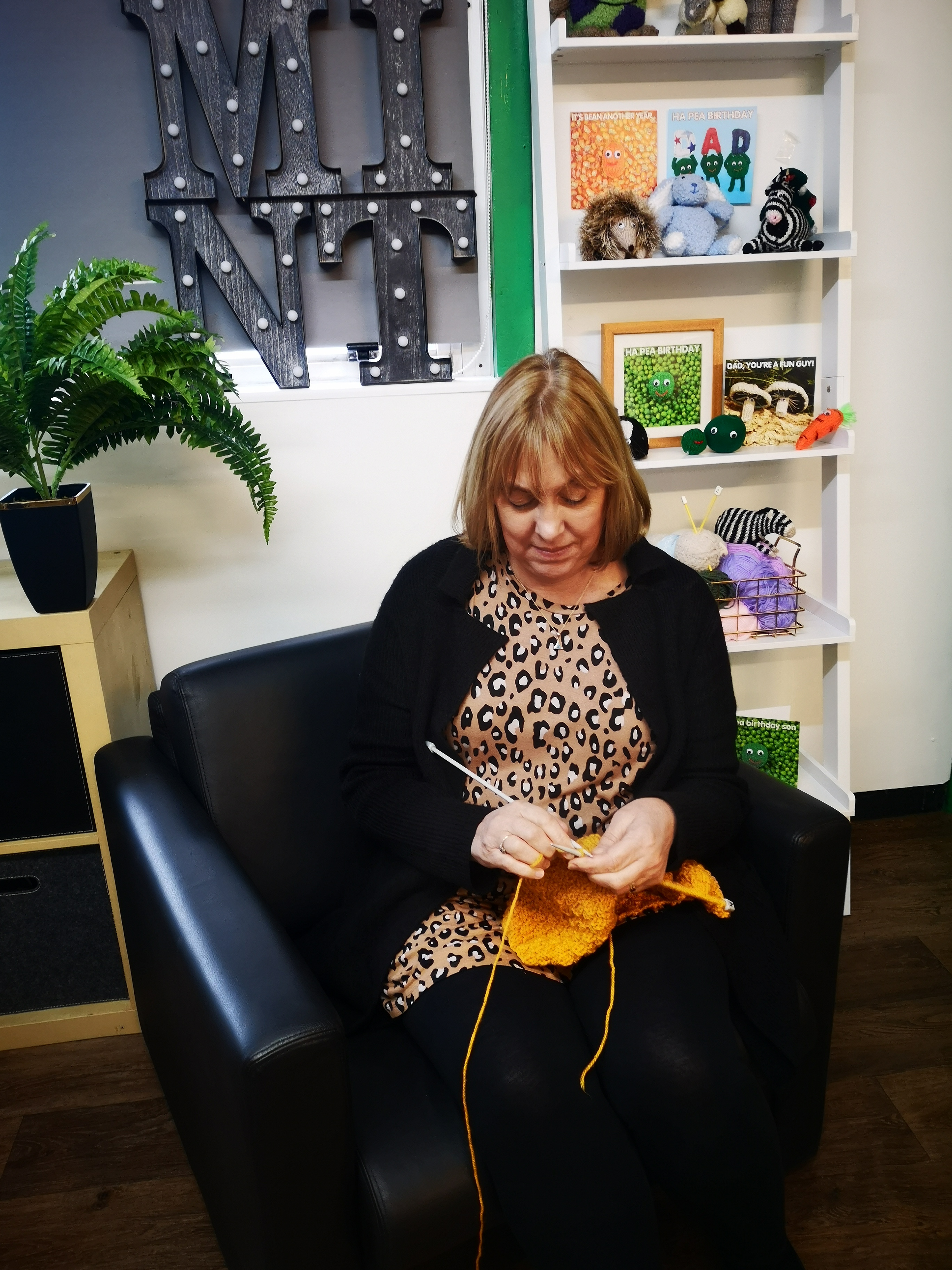 Above: Debbie Williams, co-owner of Mint Group in knitting mode.