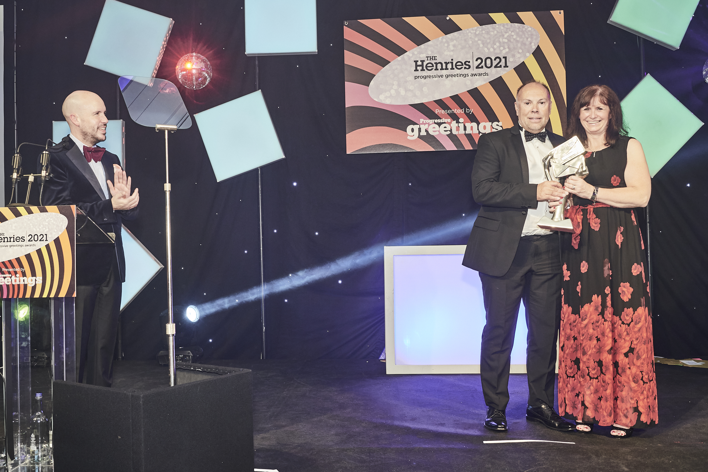 Above: Cardzone's Paul Taylor was presented with his award by Joanne Davis, md of UK Envelope Centre, sponsor of the award category, while host Tom Allen added his applause.
